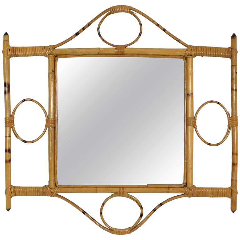 Beautiful handcrafted Franco Albini style bamboo and rattan mirror with geometric decorations on the frame. France, 1960s It can be hang in two positions. This piece has all the freshness of the Mediterranean French Riviera style and it is perfect