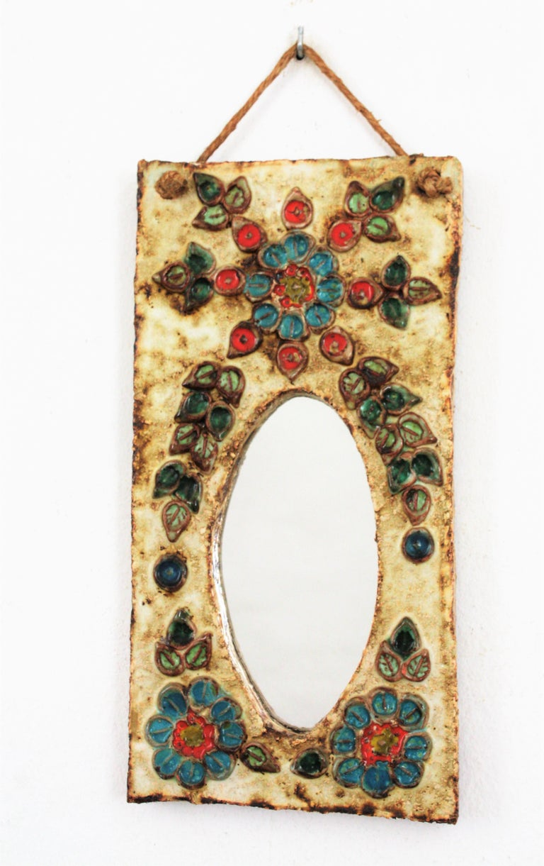 Mid-Century Modern French 1960s La Roue Vallauris Ceramic Hanging Mirror with Floral Details For Sale