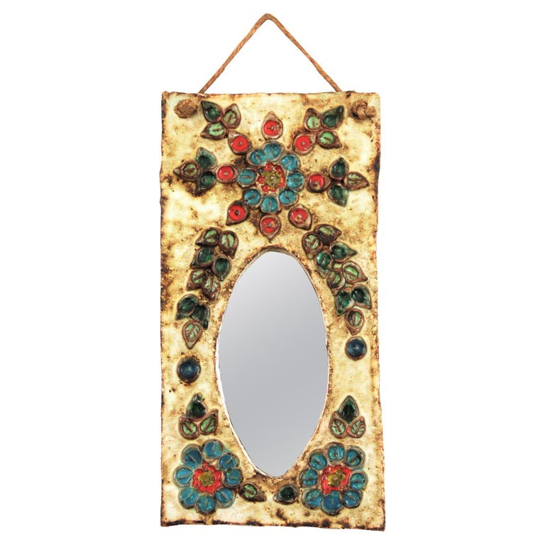 French 1960s La Roue Vallauris Ceramic Hanging Mirror with Floral Details For Sale