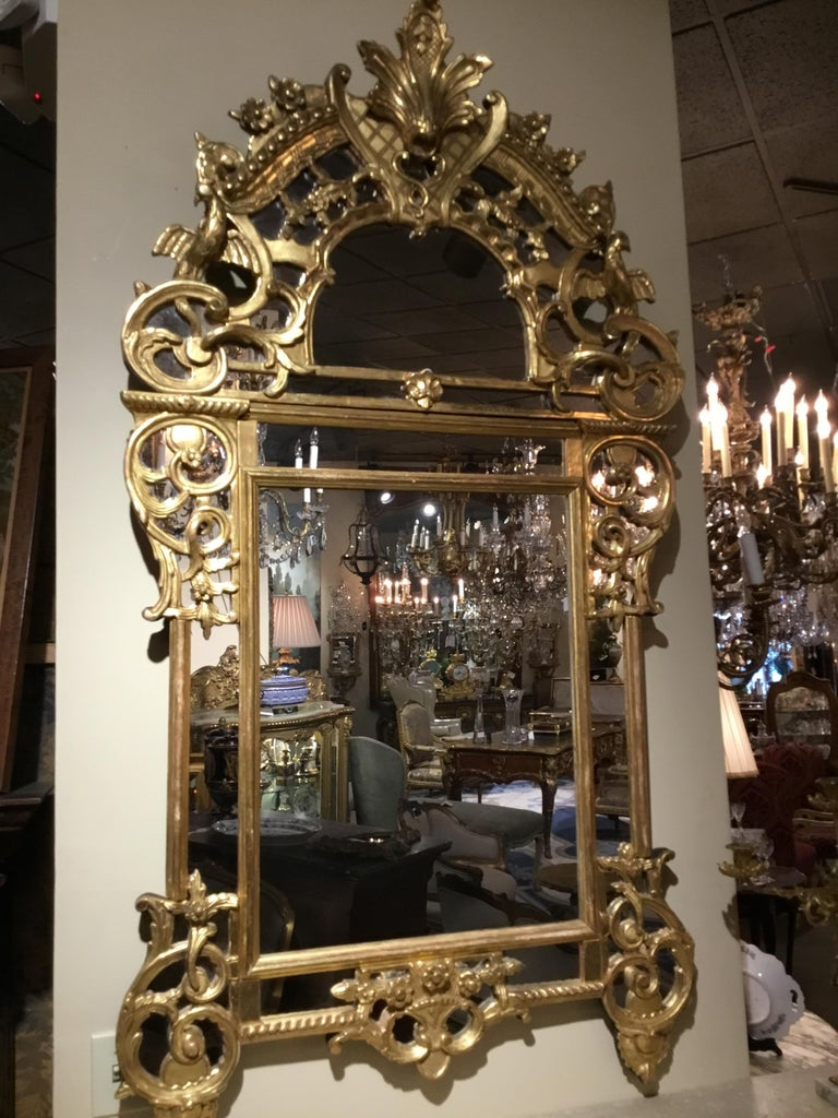 Gilt French 19th c regence  style giltwood reticulated footed mirror For Sale