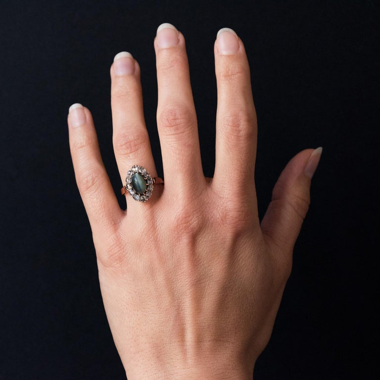 Ring in 18 karats rose gold, horse's head hallmark. This beautiful marquise ring is set with claws of an oval cabochon cat's eye surrounded by rose-cut diamonds. Total weight of the cat's eye: approximately 2.50 carats. Total weight of diamonds: