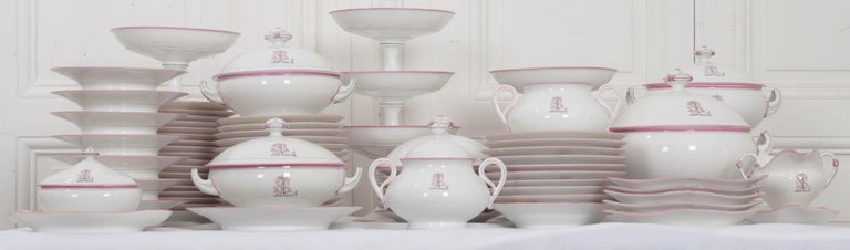 This lovely 19th century French Old Paris porcelain partial dinner service, circa 1860s, would complement most collections of Old Paris dinnerware beautifully. Each of the 95 pieces is banded in rose, a shade considered neutral in terms of Old Paris