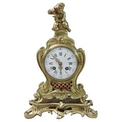 French 19th Century Brass and Gilt Rococo Style Mantel Clock by Samuel Marti