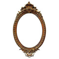 French 19th Century Carved and Gilt Framed Beveled Oval Mirror
