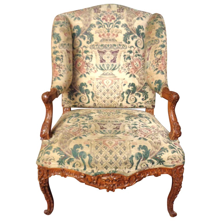 French 19th Century Carved and Upholstered Wingback Chair For Sale