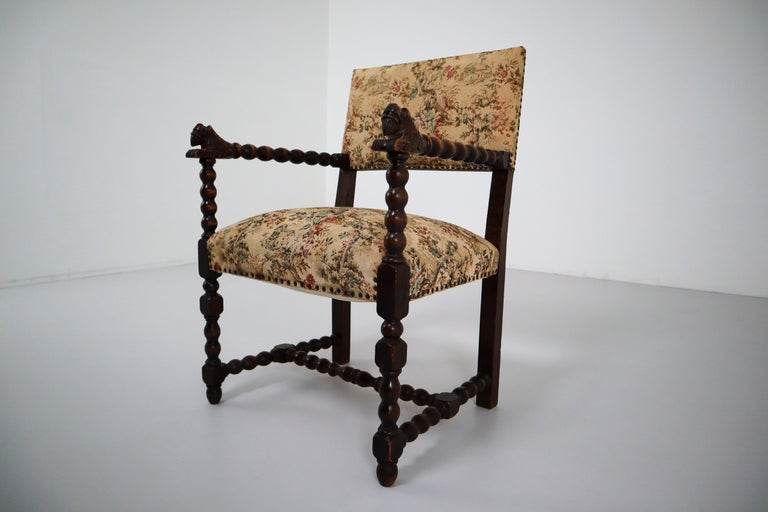 Fabulous carved oak chair from France. Original fabric that shows some minor stains and age appropriate wear. France, 1870.