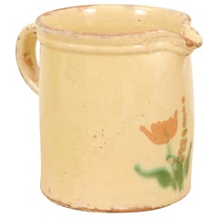 French 19th Century Cream Glazed Terracotta Pitcher with Floral Décor