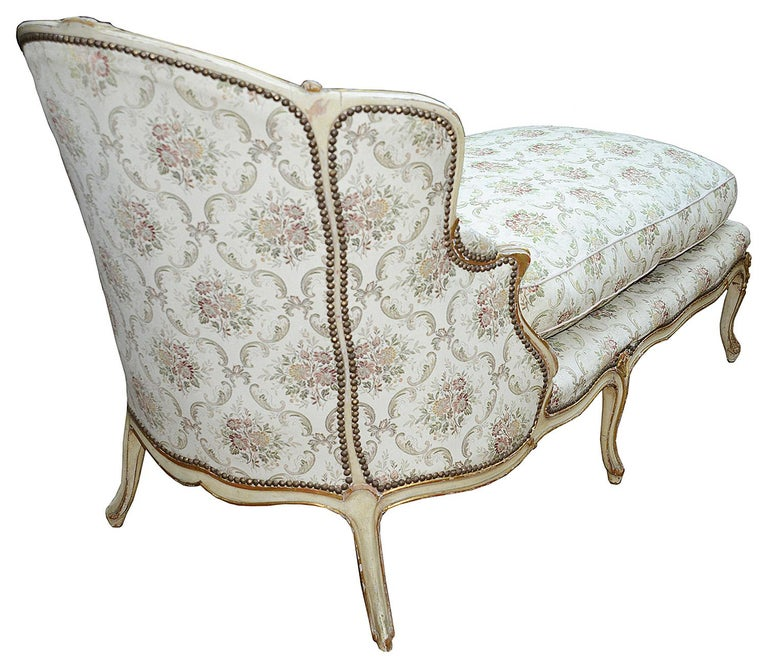 A very stylish 19th century French ivory decorated show wood daybed, raised on elegant cabriole legs.