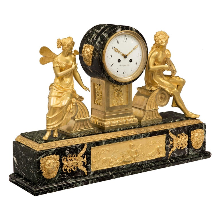 A stunning and high quality French 19th century Empire style ormolu and Vert Patricia marble clock. The clock is raised by a striking rectangular Vert de Patricia marble base with a fine mottled bottom band. The base is decorated with a beautiful