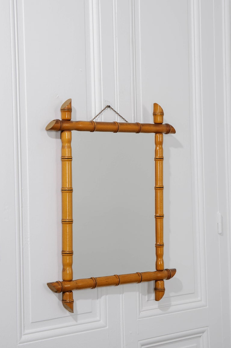 A French faux-bamboo rectangular mirror from the early 20th century is made of pine wood and has the original mirror plate.
