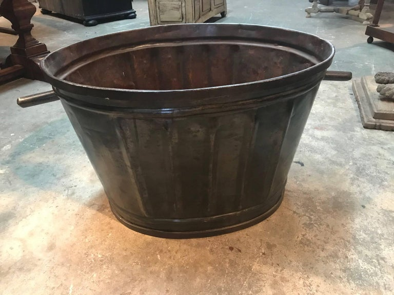 Wonderful later 19th century grape harvesting baskets - Buckets from a vineyard in the South of France. Soundly made from metal with handles. Terrific to use pool side for beach towels, by the fireplace for kindling or as jardiniers or planters.