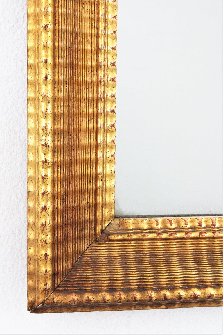 Gesso French 19th Century Louis Philippe Gold Leaf Giltwood Ribbed Carving Mirror For Sale