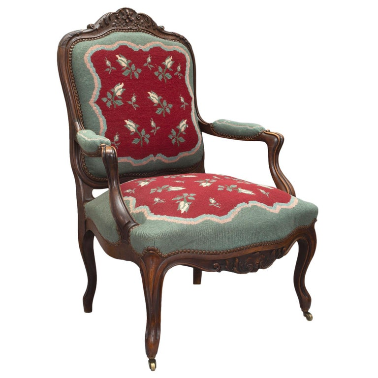An attractive pair of mid-19th century french Louis XV style carved armchairs in dark patinated oak. The pair with wide seats have a heavily carved back with scrolled acanthus leaves amidst A lattice design and blossoming flowers. The pair raised by