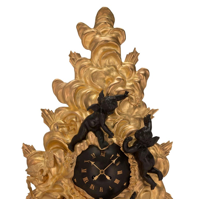 French 19th Century Louis XV St. Ormolu and Patinated Bronze Cartel Clock In Excellent Condition For Sale In West Palm Beach, FL