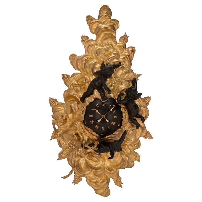 French 19th Century Louis XV St. Ormolu and Patinated Bronze Cartel Clock For Sale