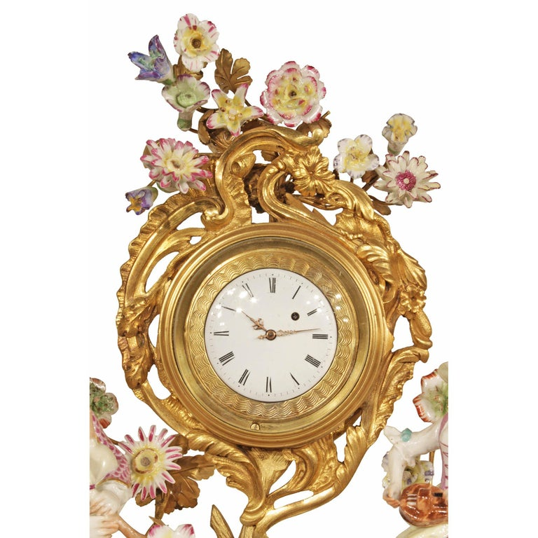 An attractive and high quality French 19th century Louis XV style porcelain and ormolu clock, signed Meissen. The clock is raised by a stunning pierced ormolu base with scrolled design and a handsome pair of guinea fowl. At the center is a scrolling