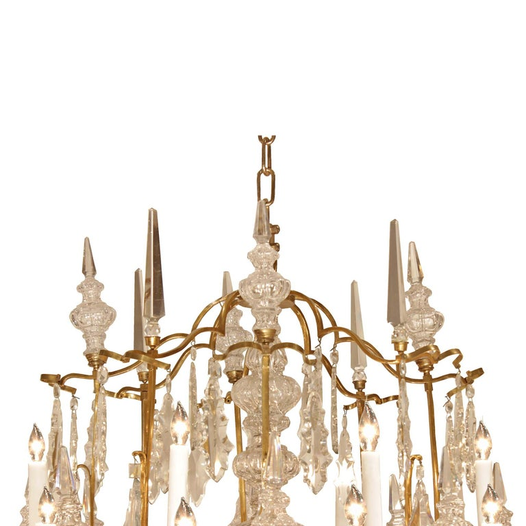 A stunning and monumental French 19th century Louis XV st. ormolu and Baccarat crystal chandelier. With large ormolu scrolled arms and twenty-four lights on two levels. The exquisite crystal central fut is surrounded by two levels of crystal