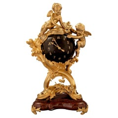 French 19th Century Louis XV Style Ormolu Bronze and Rouge Griotte Marble Clock