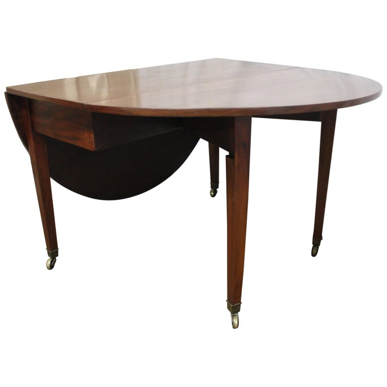 French 19th century Louis XVI drop-leaf table. Dimensions table opened: 63.5in. W x 44.25in. D x 29in. H Dimensions table closed: 20in. W x 44.25in.D x 29in. H.
