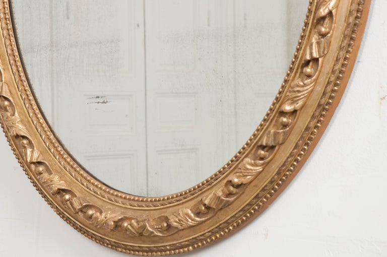 Carved French 19th Century Louis XVI Oval Giltwood Mirror For Sale