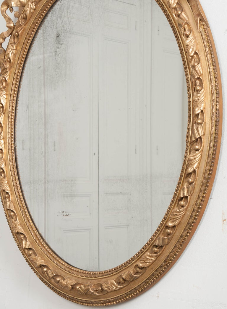 French 19th Century Louis XVI Oval Giltwood Mirror In Good Condition For Sale In Baton Rouge, LA