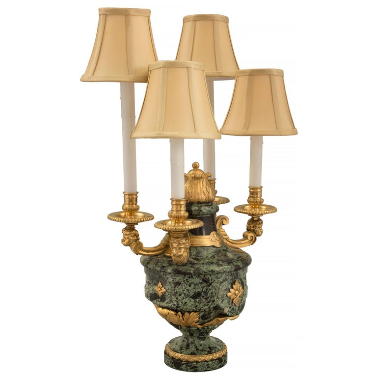 A sensational and high-quality pair of French 19th century Louis XVI st. Belle Époque period Vert Antique marble and ormolu four arm candelabra lamps, attributed to Henry Dasson. Each lamp is raised by a circular base with an elegant wrap-around