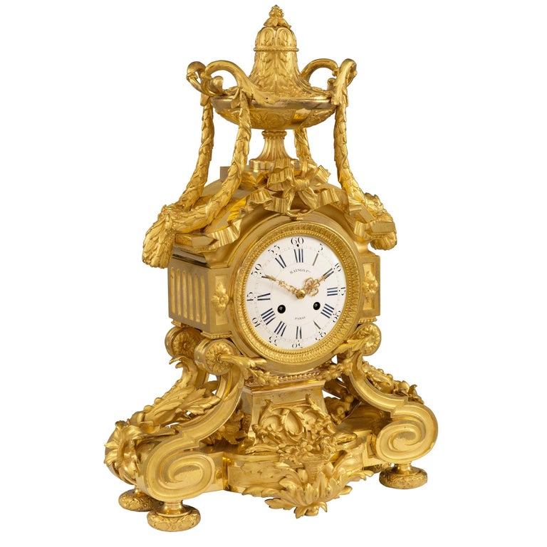 A striking and high quality French 19th century Louis XVI style Belle Époque period ormolu clock signed by Raingo Frères. The clock is raised by lovely mottled feet with a floral design. Below the clock face is a stunning and richly chased acanthus