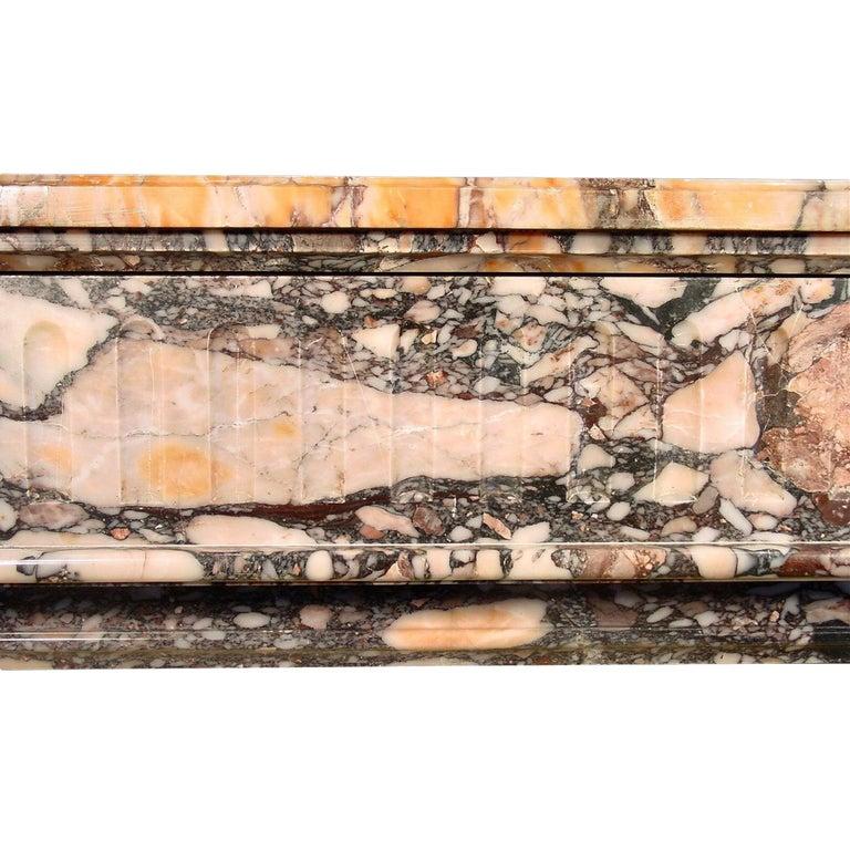 A spectacular French Louis XVI st. 19th century Brèche de Sciro marble mantel with fluted sides and apron. With wonderful colors and proportions. Interior dimensions H 32.5