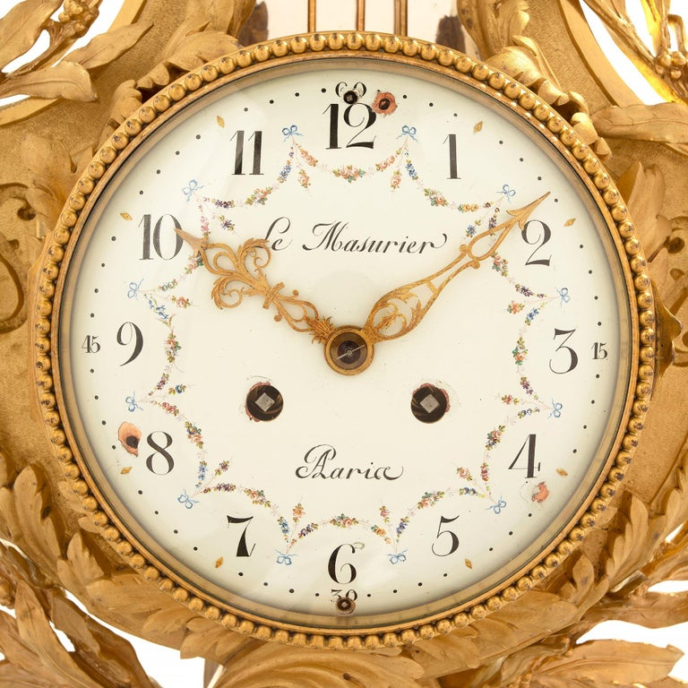 French 19th Century Louis XVI Style Cartel Clock, Signed Le Masurier, Paris In Excellent Condition For Sale In West Palm Beach, FL