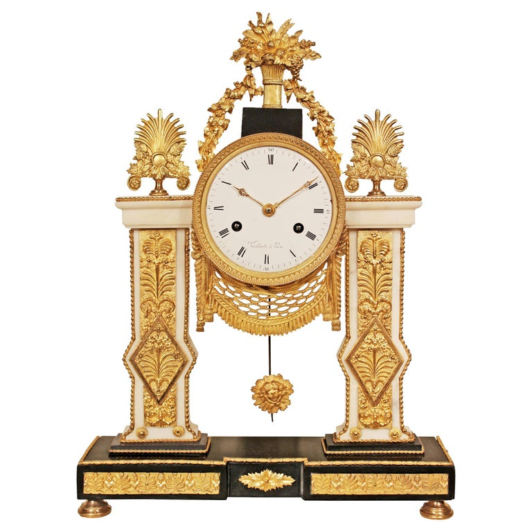 French 19th Century Louis XVI Style Marble and Ormolu Clock For Sale