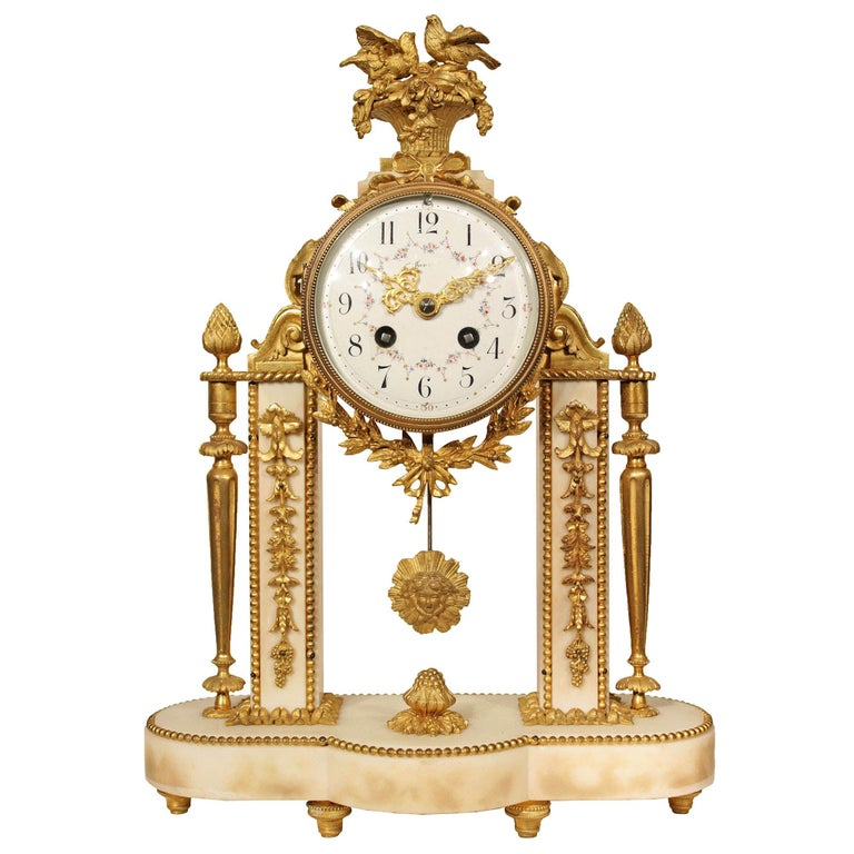 French 19th Century Louis XVI Style Marble and Ormolu Portique Clock For Sale