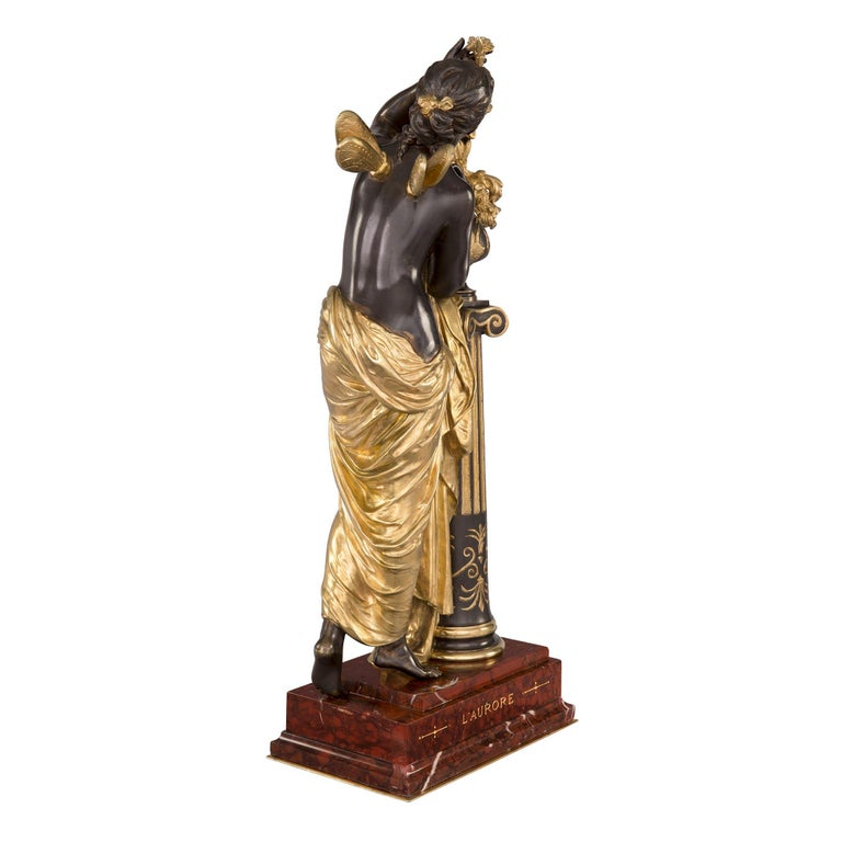 A very impressive French mid-19th century Louis XVI style ormolu and patinated bronze statue by Mathurin Moreau titled