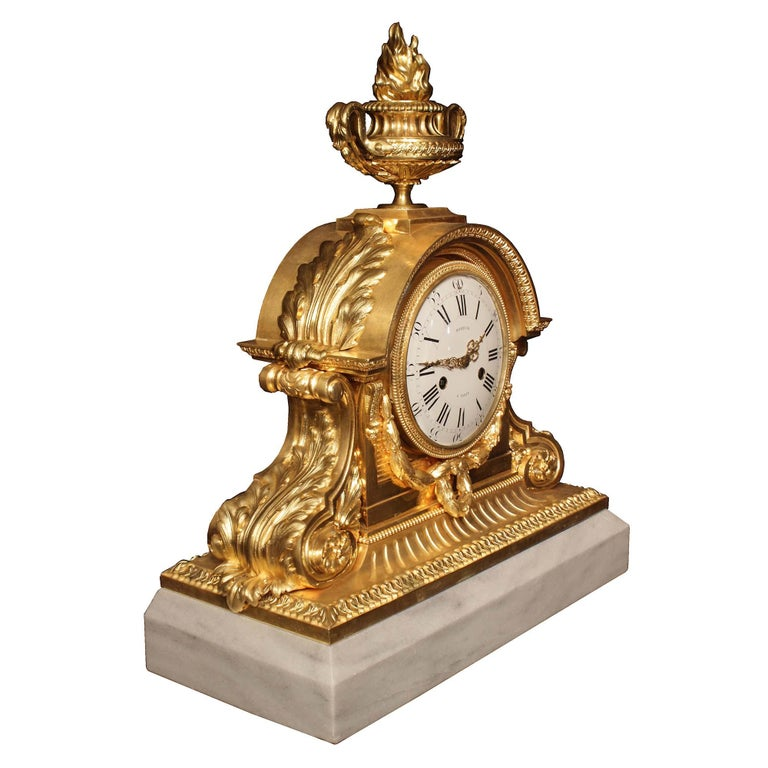 A striking and grand scale French 19th century Louis XVI style ormolu and marble clock, signed Marquis à Paris. The mechanism is manufactured by Honoré Pons. The clock is raised on an impressive solid white Carrara marble rectangular base with a cut