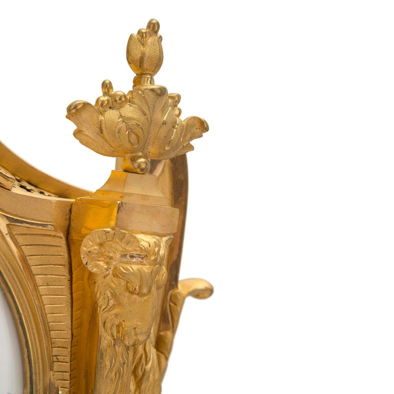 French 19th Century Louis XVI St. Ormolu Cartel Clock, by L. Marchand For Sale 2