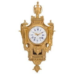 French 19th Century Louis XVI St. Ormolu Cartel Clock, by L. Marchand