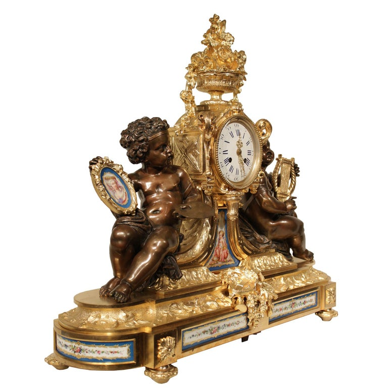 A magnificent French 19th century Louis XVI style ormolu clock. The clock is raised on topie shaped feet below the oval base decorated with beautiful Sèvres Porcelain inserts accented by ormolu rosette blocks, and a central mount of musical