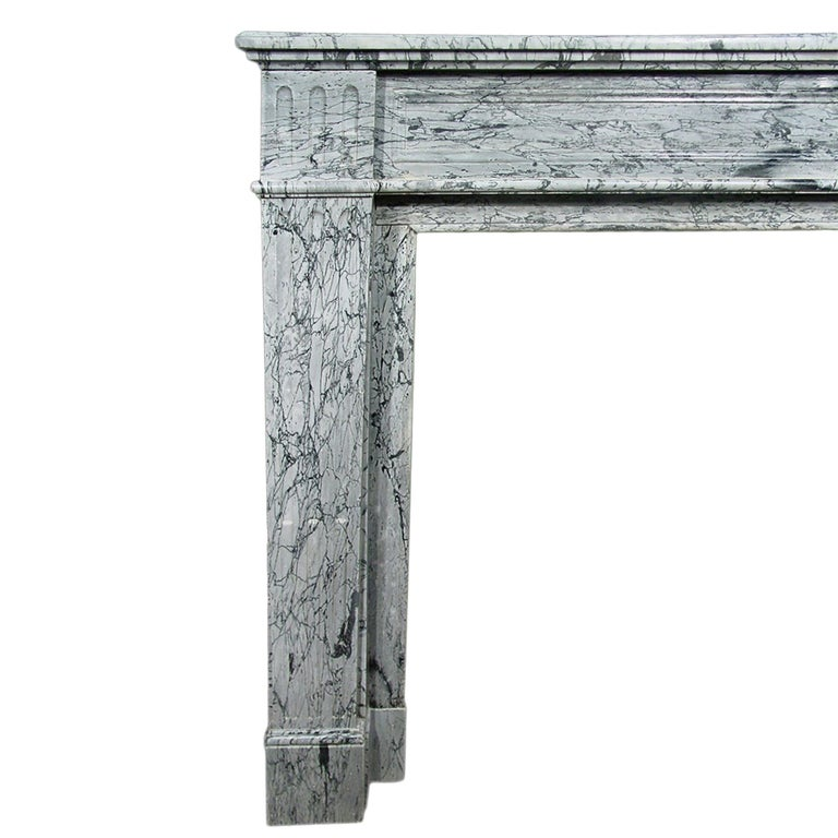 A very attractive French 19th century Louis XVI style Paloma marble mantel. The mantel is raised on elegantly fluted jambs. The bandeau is decorated with a rectangular moulded border design. The shelf has a reversed moulded border.  Measures: INT: