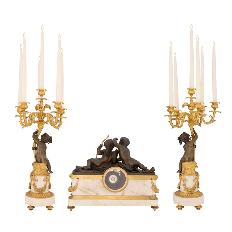 Patinated French 19th Century Louis XVI Style Three-Piece Garniture Set For Sale