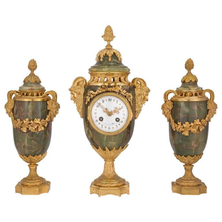 French 19th Century Louis XVI Style Three-Piece Onyx and Ormolu Garniture Set For Sale