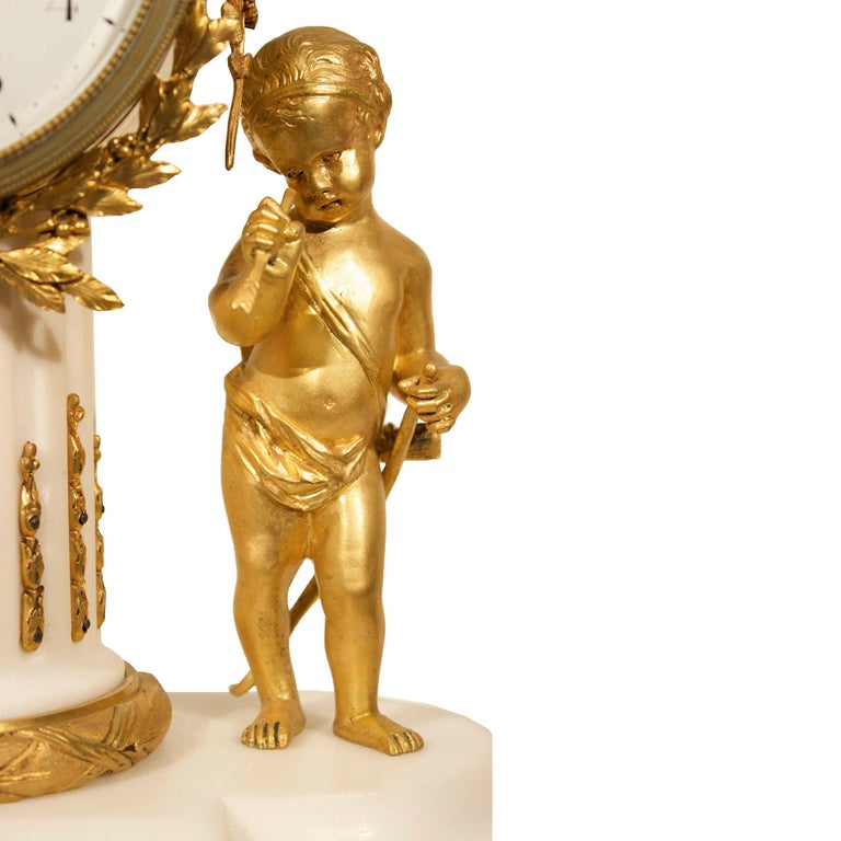 French 19th Century Louis XVI Style White Carrara Marble Clock with Ormolu Mounts For Sale