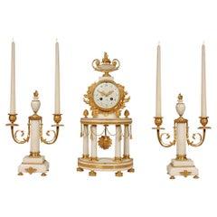 French 19th Century Louis XVI St. White Carrara Marble Garniture Clock Set