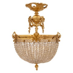 French 19th Century Louis XVI Style Ormolu, Bronze and Crystal Chandelier