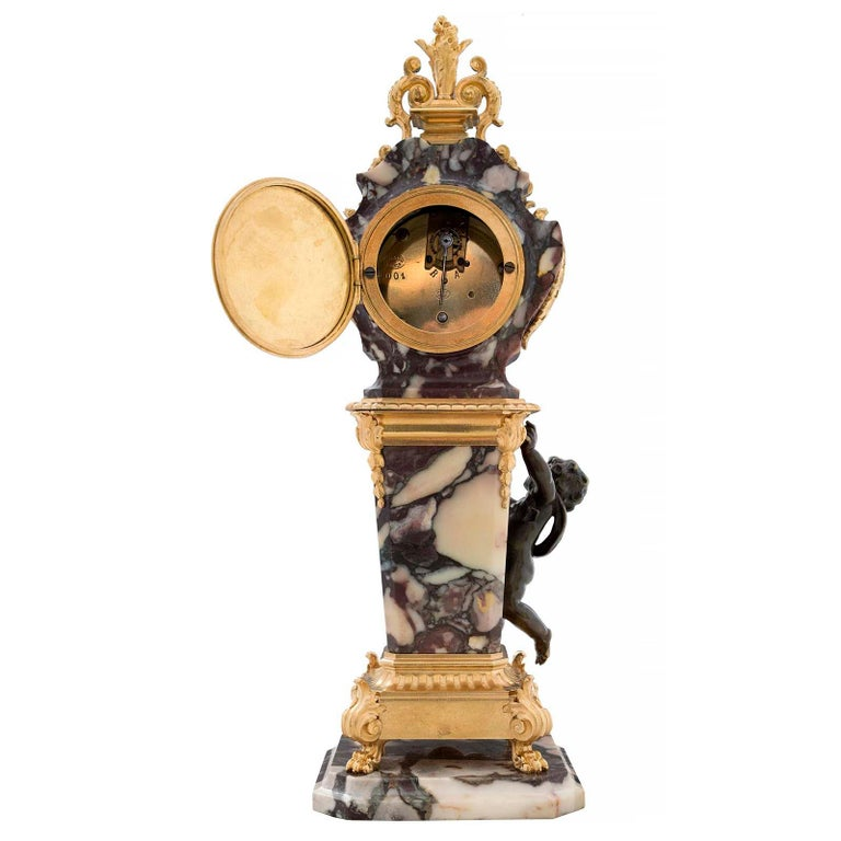 Patinated French 19th Century Louis XVI Style Ormolu, Bronze and Marble Clock For Sale