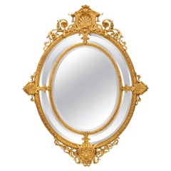 French 19th Century Louis XVI Style Oval Double Framed Giltwood Mirror