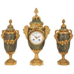 French 19th Century Louis XVI Style Three-Piece Onyx and Ormolu Garniture Set
