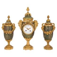 French 19th Century Louis XVI Style Three-Piece Onyx and Ormolu Garniture Set