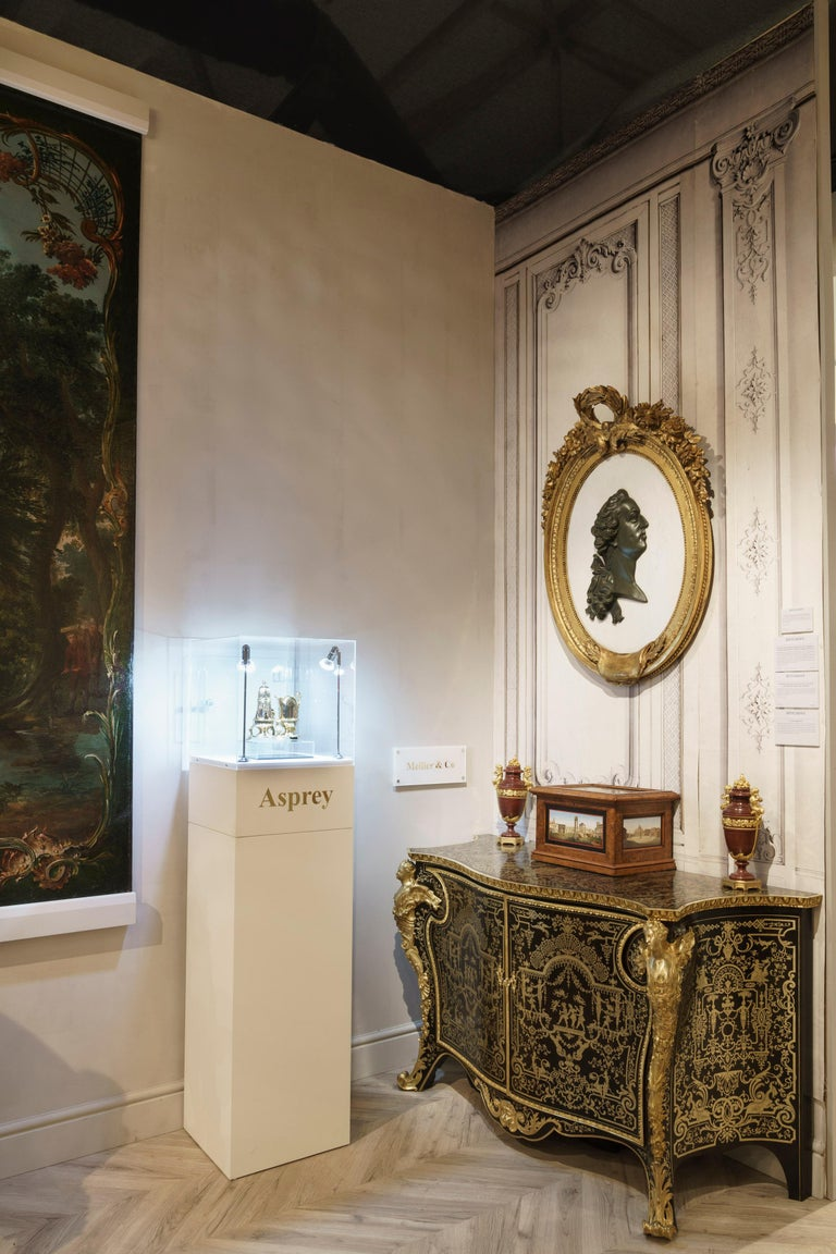 A neoclassical portrait of King Louis XVI.  Housed within an exuberantly carved gold giltwood frame of elliptical form, the conformingly shaped white Cararra marble plaque is mounted with the right profile view of the subject, in a patinated black