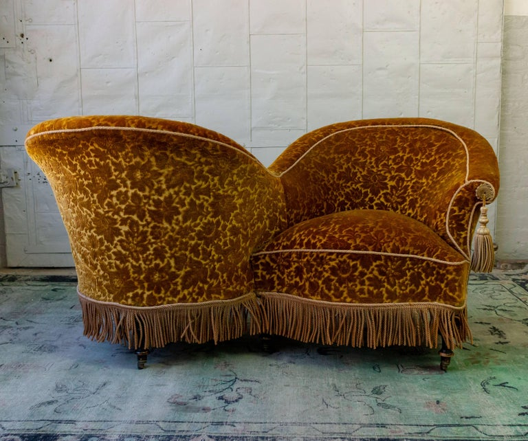 Unusual French armchair (s) called tête-à-tête in French, or a Conversation chair, 19th century Napoleon III period. In very good condition, upholstery most likely 1930s.