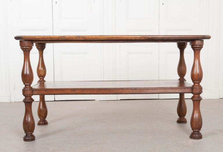 Beautiful, quarter sawn graining enrich the already lustrous oak surface of this amazing French drapers table. Originally used by tailors and seamstresses, these lengthy tables would provide a work surface long enough for yards of fabric to be laid