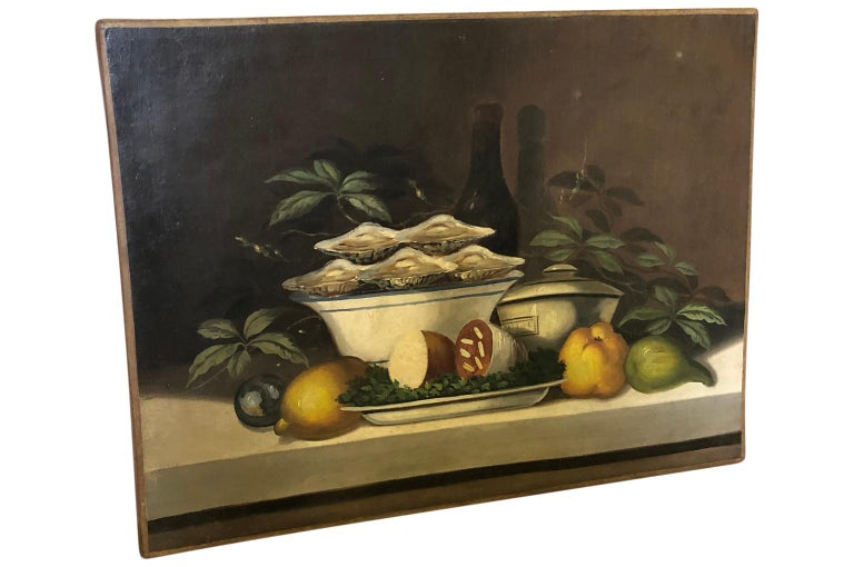 A delightful French 19th century oil painting from the South of France. A delicious subject mater - Huitres - Oysters on the half shell, saucisson sec, wine and more. A perfect picnic.